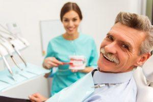 gray-haired man visiting his dentist for seniors in Port Orange